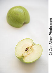 Slices of green healthy and antitoxin apple fruits on a white background