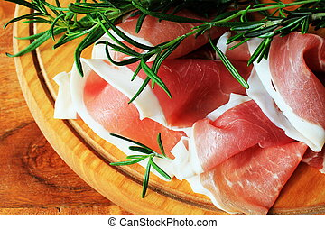 slices of ham on a cutting board