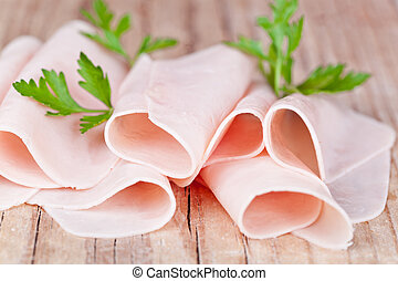 slices of ham with parsley