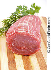 Slices of lean meat with herbs for seasoning