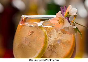 Slices of lemon in drink.