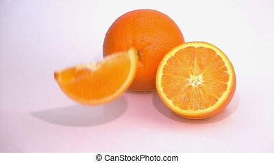 Slices of Orange are Falling on the Table.