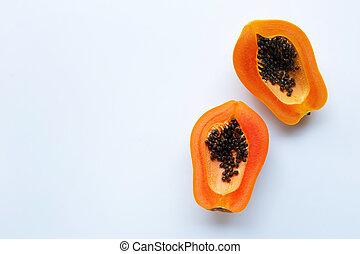 Slices of papaya fruit on a white background.