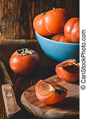 Slices of persimmon on cutting board