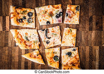 Slices of pizza on a wooden board