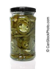Slices of preserved Jalapeno pepper in glass jar
