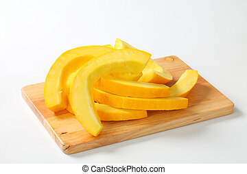 slices of pumpkin on a cutting board