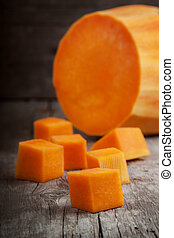 slices of pumpkin on a wooden table