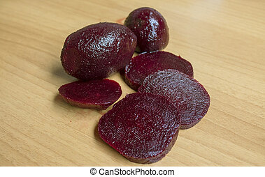 slices of red beet on the wood