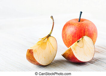 Slices of ripe apples on a wooden table