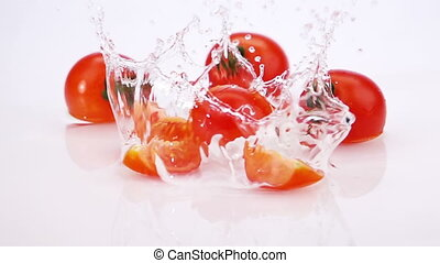 Slices of Ripe Tomato Falls on the Table.