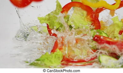 Slices of Ripe Vegetables are Falling on the Table.
