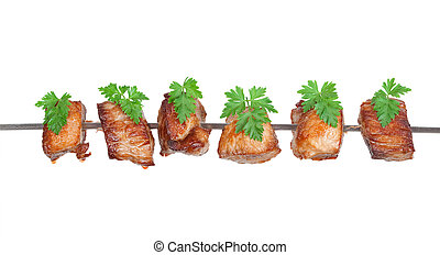 Slices of roast meat on a skewer with parsley
