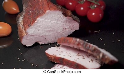 Slices of smoked meat falls in slow motion