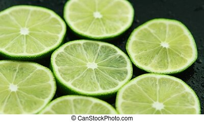 Slices of sour fresh lime - Closeup circle slices of fresh...