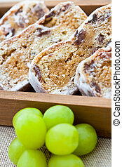 Slices of stollen cake with fresh green grapes
