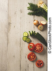 Slices of tomatoes and cucumbers with fresh onions and dill