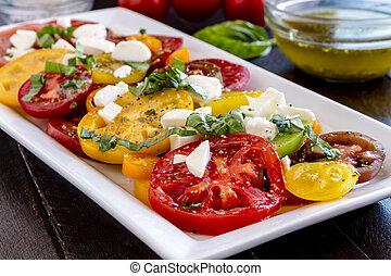 Slices of vine ripe tomato varieties - Slices of vine ripe...