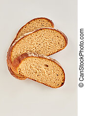 Slices of wheat bread, top view.