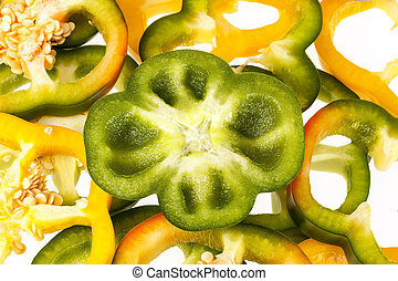 slices of yellow and green pepper vegatebles on white background