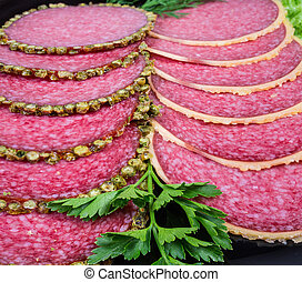 Slices salami with peppercorns crust and parmesan crust, close-up