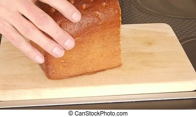 Slicing bread - Close up of slicing bread on a wooden board