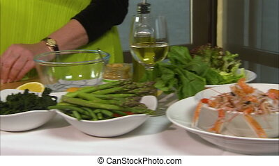 Slicing chunks of carrots - A moving shot of a woman slicing...
