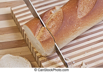 Close up image of slicing french baguette bread