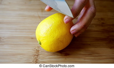 Slicing Lemon - Close up of slicing lemon with only fingers...