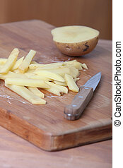 slicing potatoes for chips