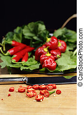 slicing red hot peppers