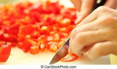 slicing red sweet bell pepper. food
