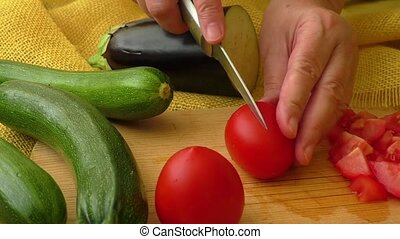 Slicing tomato on chopping board