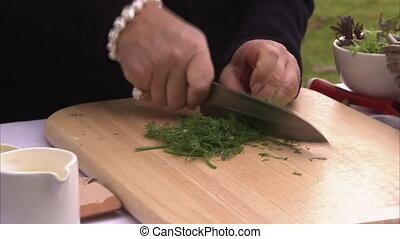 Slicing vegetables shot - A medium shot of a person slicing...