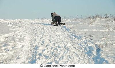 slide downhill on a sledge