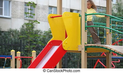 Little girl sliding down the chute