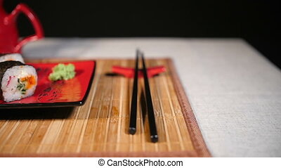 Slide Motion of Sushi With Chopsticks and Sauce - Slide...