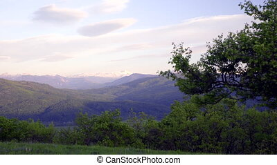 Slide shot of  snow-capped peaks