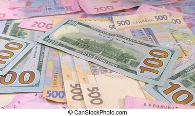 Slider money on the table. Denominations. Dollar and hryvnia