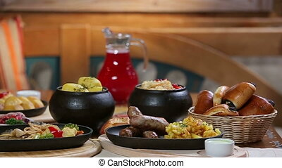 Slider panorama of fresh hot potato dishes in the morning countryside beautifully laid table