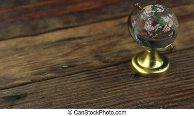 Slider shot. Close-up glass globe for study, standing on a...