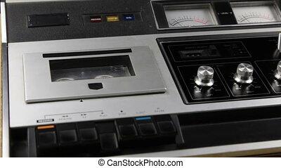 Slider shot. Retro cassette tape player. Close-up