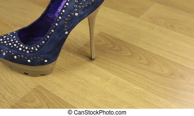 Slider shot. Stylish classic women's denim shoes with high heels. Copy space.