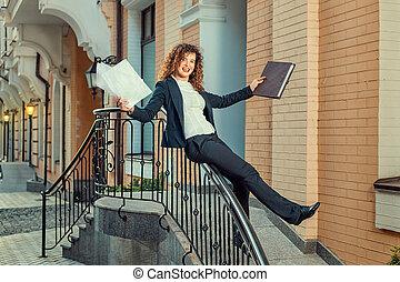 Slides down the banisters girl. - Happily smiling girl slips...