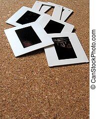 Slides - Photo slides and frames on a board