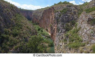Sliding camera of Canyon and suspension bridges in Chulilla...