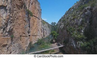 Sliding camera of Canyon and suspension bridges in Chulilla...