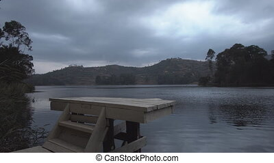 Sliding camera over bunyonyi lake springboard - Wide angle...