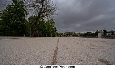 Sliding camera over El retiro walk in Madrid downtown -...