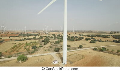 Sliding camera over wind turbine, aerial view